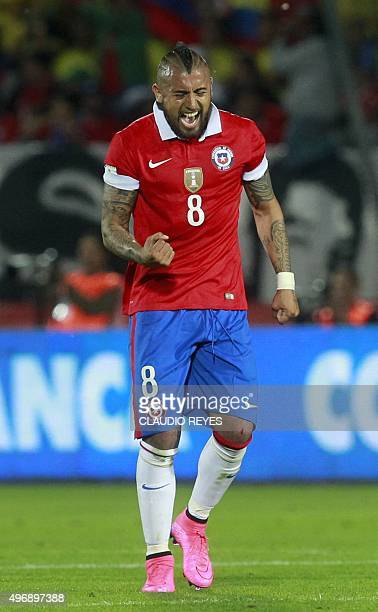Chile's Arturo Vidal celebrates after scoring against Colombia during their Russia 2018 FIFA World Cup South American Qualifiers football match in...