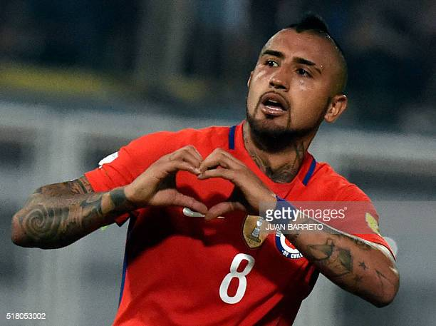 Chile's Arturo Vidal celebrates after scoring against Venezuela during their Russia 2018 FIFA World Cup South American Qualifiers' football match in...