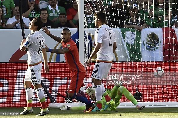 Chile's Arturo Vidal celebrates as Mexico's goalkeeper Guillermo Ochoa fails to stop a ball kicked by Edson Puch during the Copa America Centenario...