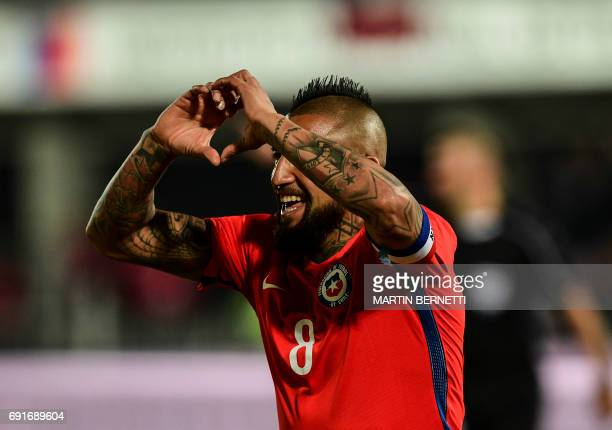 Chile's Arturo Vidal celebrates his goal against Burkina Faso during a friendly match for the FIFA Confederations Cup Russia 2017 in Santiago on June...