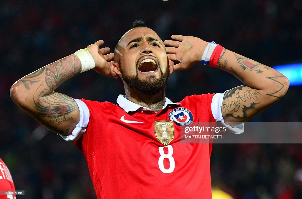 Chile's Arturo Vidal gestures at the crowd during their Russia 2018 FIFA World Cup qualifiers match against Brazil at the Nacional stadium in...