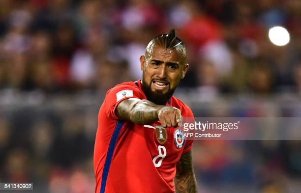 Chile's Arturo Vidal gestures during the 2018 World Cup qualifier football match against Paraguay in Santiago on August 31 2017 / AFP PHOTO / Martin...