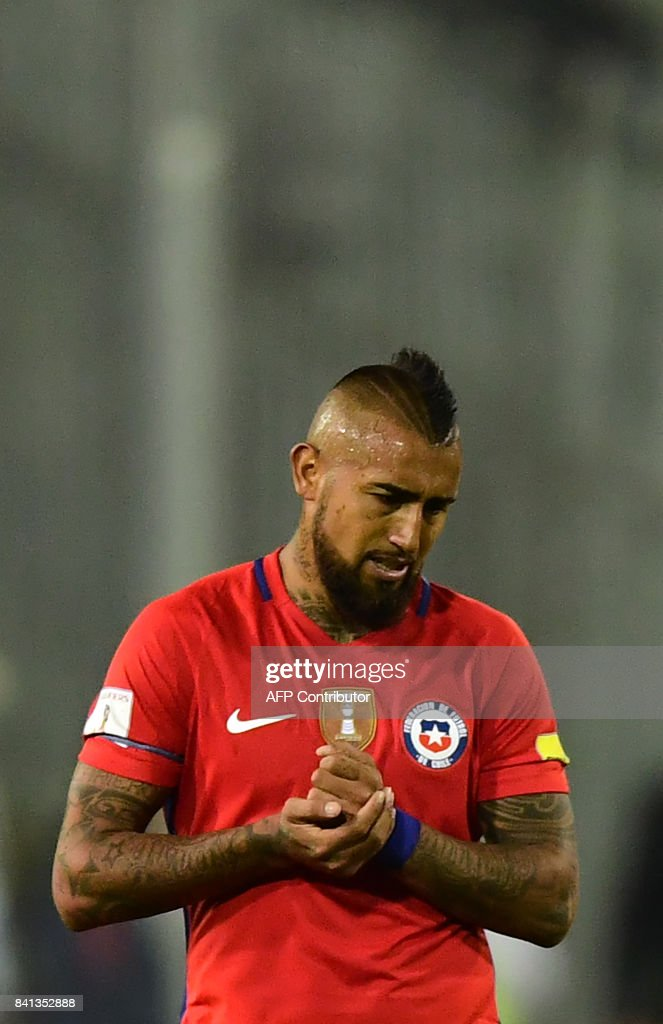Chile's Arturo Vidal reacts after losing against Paraguay during their 2018 World Cup qualifier football match, in Santiago, on August 31, 2017. /