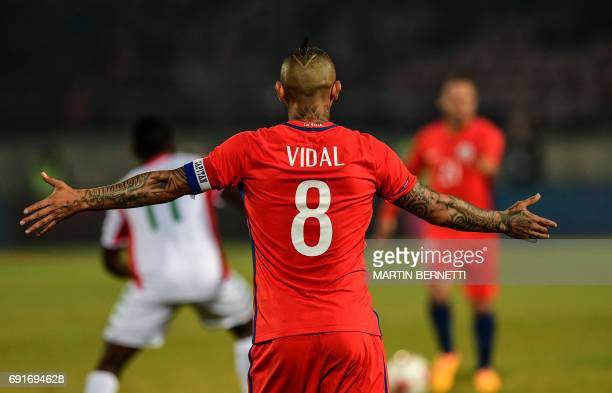 Chile's Arturo Vidal reacts against Burkina Faso during a friendly match for the FIFA Confederations Cup Russia 2017 in Santiago on June 2 2017 / AFP...