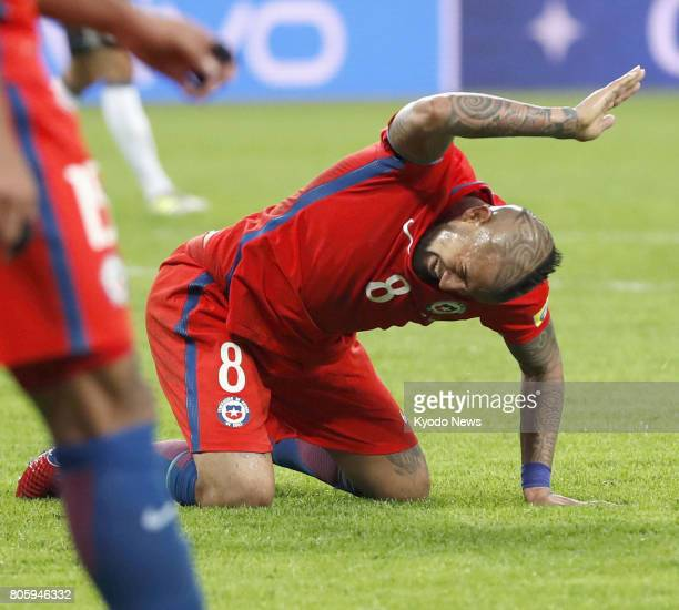 Chile's Arturo Vidal slams the ground in frustration after failing to shoot during the second half of the Confederations Cup final against Germany in...