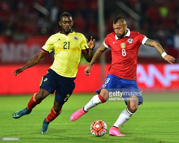 Chile's Arturo Vidal tries to get away from Colombia's Jackson Martinez during their Russia 2018 FIFA World Cup South American Qualifiers football...