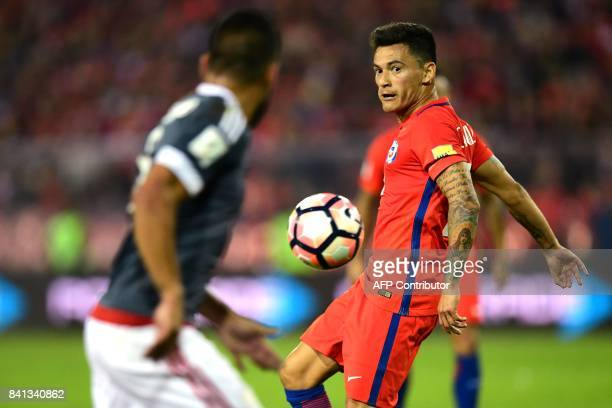 Chile's Charles Aranguiz eyes the ball during the 2018 World Cup qualifier football match against Paraguay in Santiago on August 31 2017 / AFP PHOTO...