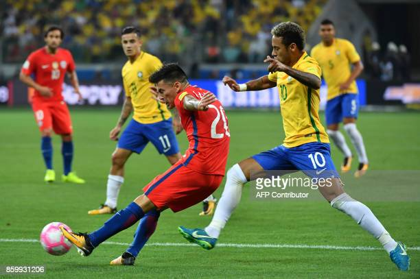 Chile's Charles Aranguiz is marked by Brazil's Neymar during their 2018 World Cup football qualifier match in Sao Paulo Brazil on October 10 2017 /...
