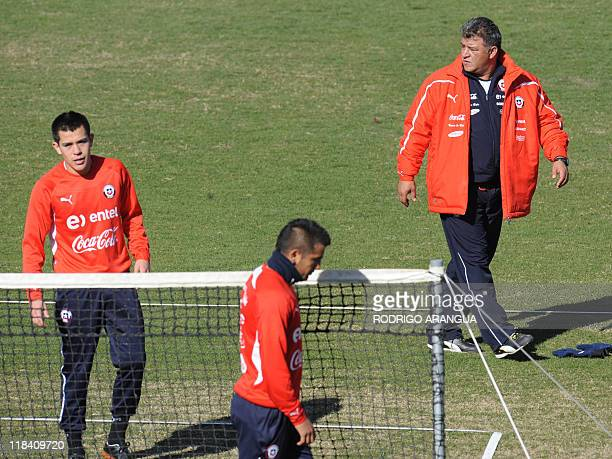 Chile's coach Claudio Borghi looks at his players during a training session in Mendoza Argentina on July 7 2011 Chile will face Uruguay next July 8...