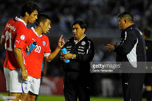 Chile's coach Claudio Borghi watches his players during their match between Uruguay and Chile as part of the third round of the the South American...