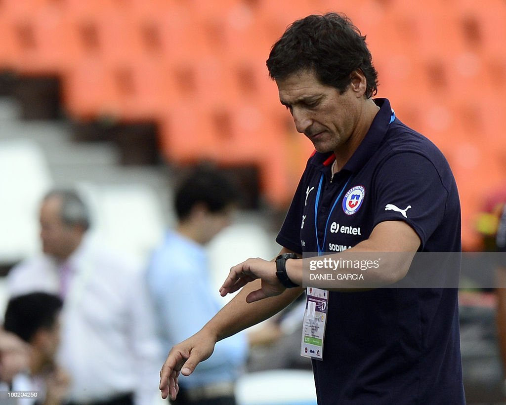 Chile's coach Mario Salas check his watch after the Uruguayan goal during the South American U-20 final round football match at Malvinas Argentinas stadium in Mendoza, Argentina, on January 27, 2013. Four teams will qualify for the FIFA U-20 World Cup Turkey 2013. Uruguay won 1-0.