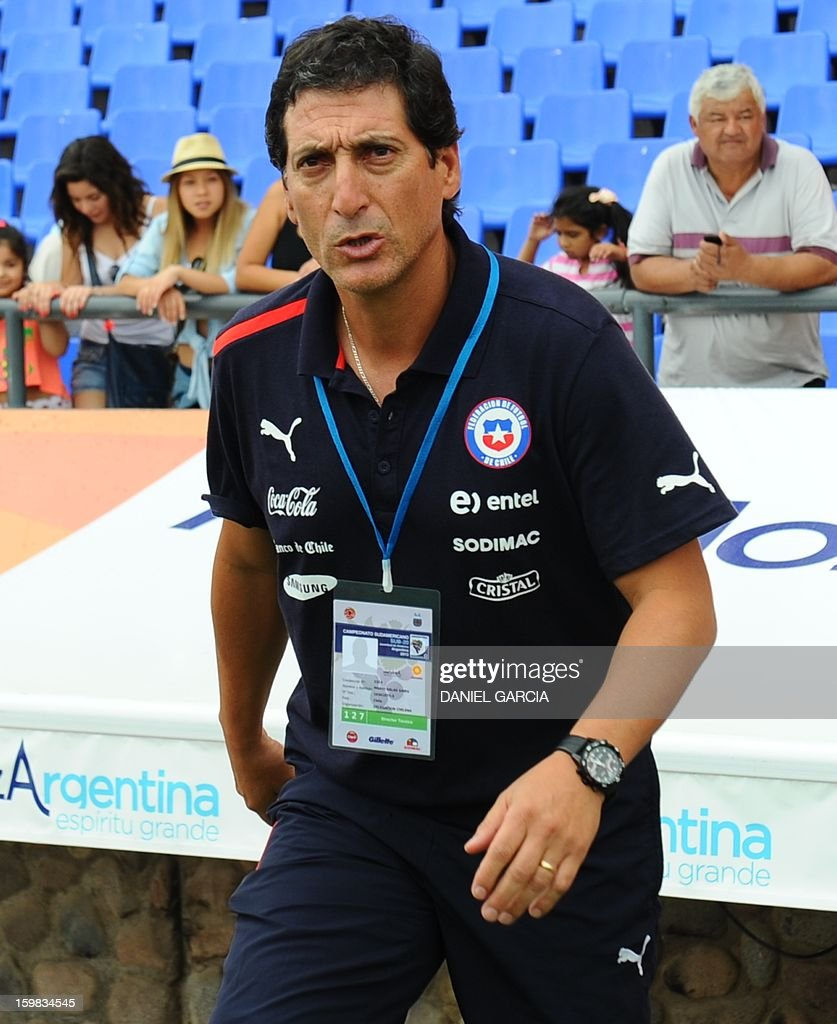 Chile's coach Mario Salas gestures during their South American U-20 final round football match against Paraguay at Malvinas Argentinas stadium in Mendoza, Argentina, on January 20, 2013. Four teams will qualify for the FIFA U-20 World Cup Turkey 2013.