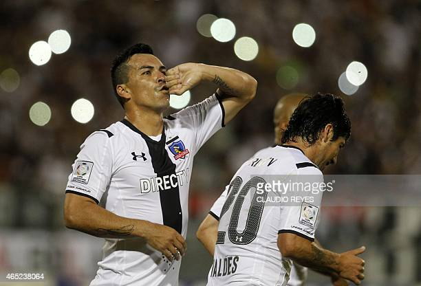Chile's Colo Colo footballer Esteban Paredes celebrates with teammates after scoring against Mexico's Atlas during their Copa Libertadores football...