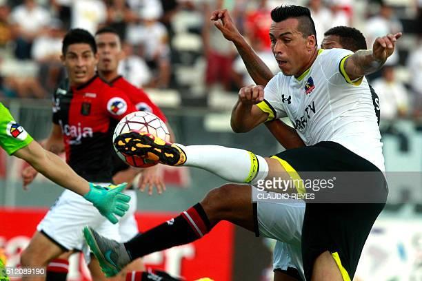 Chile's Colo Colo player Esteban Paredes kicks the ball against Peru's Melgar during their Copa Libertadores football match at the Nacional stadium...