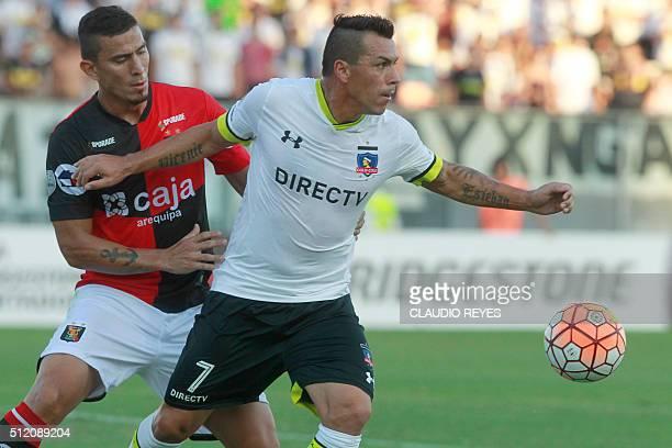 Chile's Colo Colo player Esteban Paredes vies for the ball with Peru's Melgar player Juan Bolanos during their Copa Libertadores football match at...