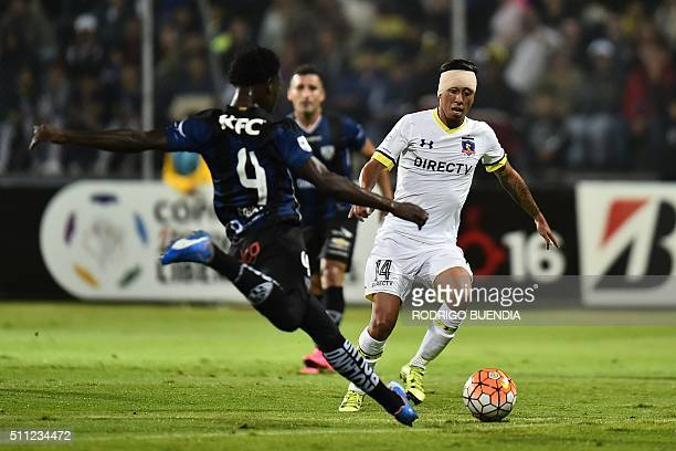Chile's Colo Colo player Gonzalo Martin Rodriguez vies for the ball with Luis Caicedo of Ecuador's Independiente del Valle during their 2016 Copa...