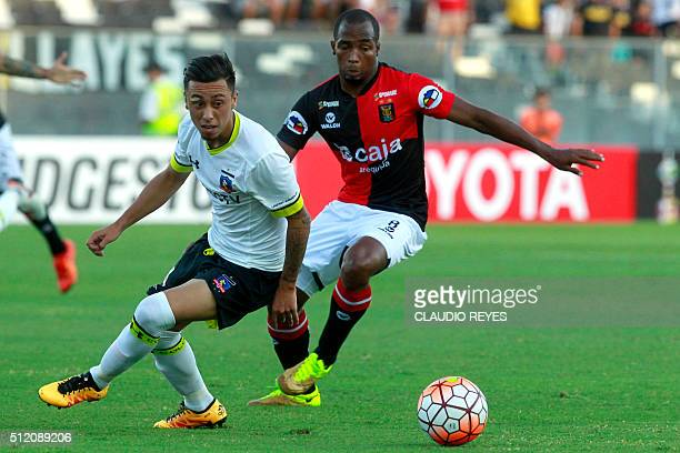 Chile's Colo Colo player Martin Rodriguez vies for the ball with Peru's Melgar player Dahwling Leudo during their Copa Libertadores football match at...
