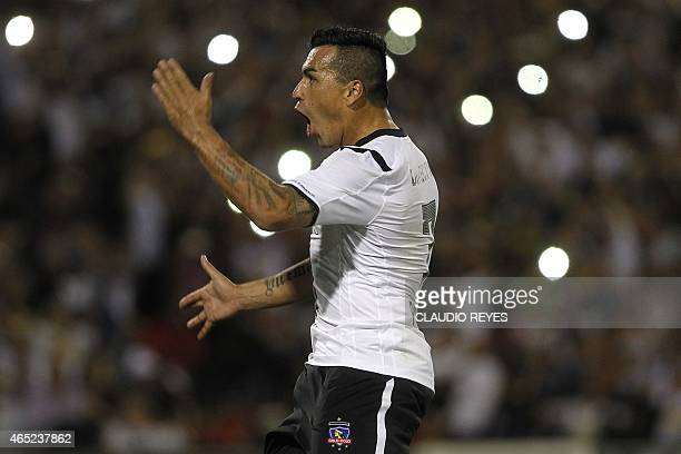 Chile's Colo Colo's footballer Esteban Paredes celebrates after scoring against Mexico's Atlas during their Copa Libertadores football match at the...
