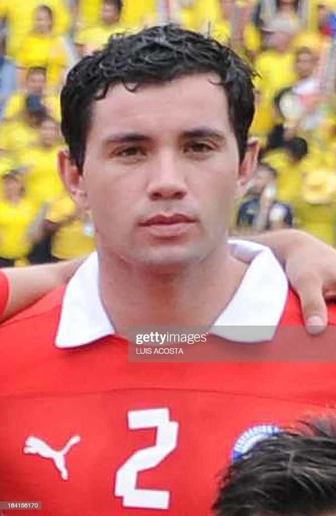 Chile's defender Eugenio Mena is pictured before the start of the Brazil 2014 FIFA World Cup South American qualifier match against Colombia, in Barranquilla, Colombia, on October 11, 2013.