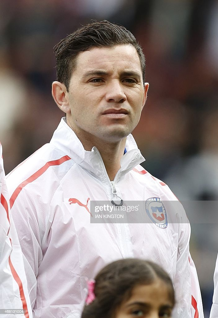 Chile's defender <a gi-track='captionPersonalityLinkClicked' href=/galleries/search?phrase=Eugenio+Mena&family=editorial&specificpeople=5900221 ng-click='$event.stopPropagation()'>Eugenio Mena</a> lines up ahead of the friendly international football match between Brazil and Chile at The Emirates Stadium in London on March 29, 2015. Brazil won the game 1-0.