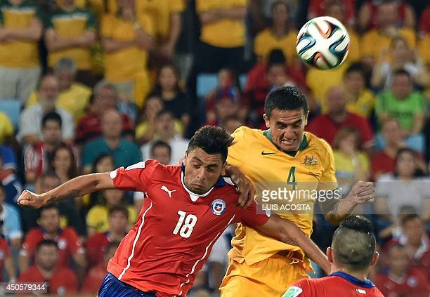 Chile's defender Gonzalo Jara and Australia's forward Tim Cahill vie for the ball during a Group B football match between Chile and Australia at the...