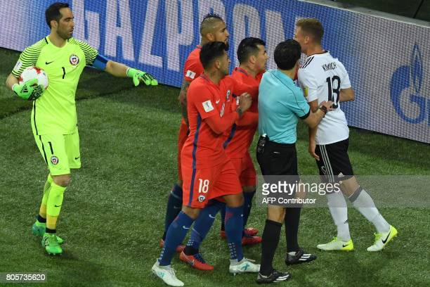 Chile's defender Gonzalo Jara and Chile's defender Gary Medel react as Chile's midfielder Arturo Vidal and Germany's defender Joshua Kimmich argue...