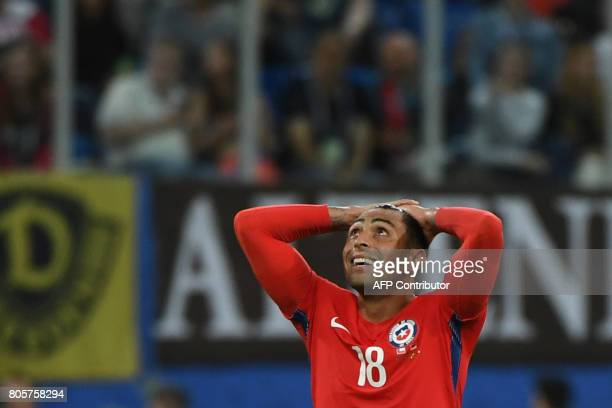 Chile's defender Gonzalo Jara reacts during the 2017 Confederations Cup final football match between Chile and Germany at the Saint Petersburg...