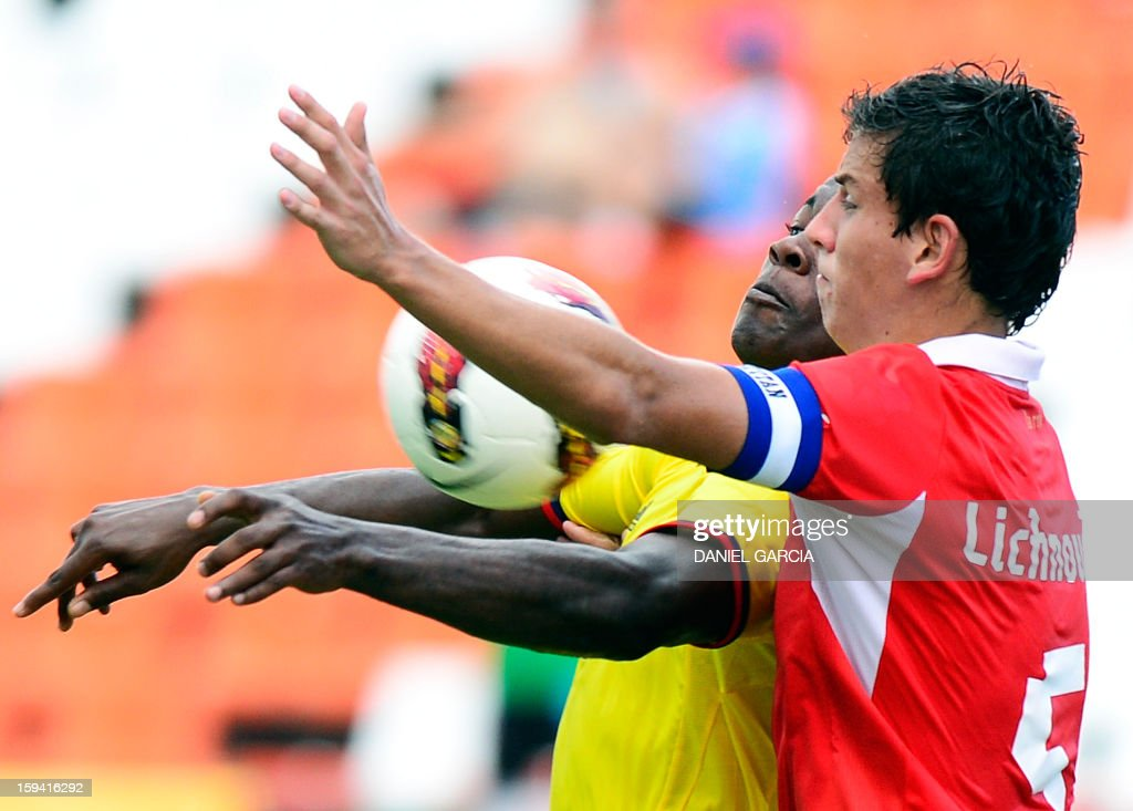 Chile's defender Igor Lichnovsky vies for the ball with Colombia's forward Jhon Cordoba during their Group A South American U-20 tournament football match at Malvinas Argentinas stadium in Mendoza, Argentina, on January 13, 2013. Four South American teams will qualify for the FIFA U-20 World Cup Turkey 2013.