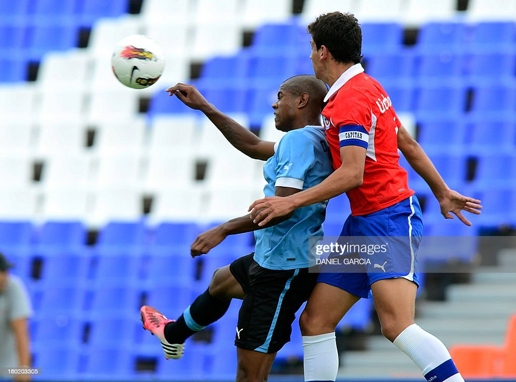 Chile's defender Igor Lichnovsky vies for the ball with Uruguay's forward Diego Rolan during their South American U-20 final round football match at Malvinas Argentinas stadium in Mendoza, Argentina, on January 27, 2013. Four South American teams will qualify for the FIFA U-20 World Cup Turkey 2013.