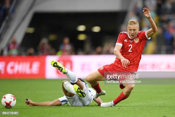 Chile's defender Jean Beausejour and Russia's defender Igor Smolnikov vie for the ball during a friendly football match between Russia and Chile at...