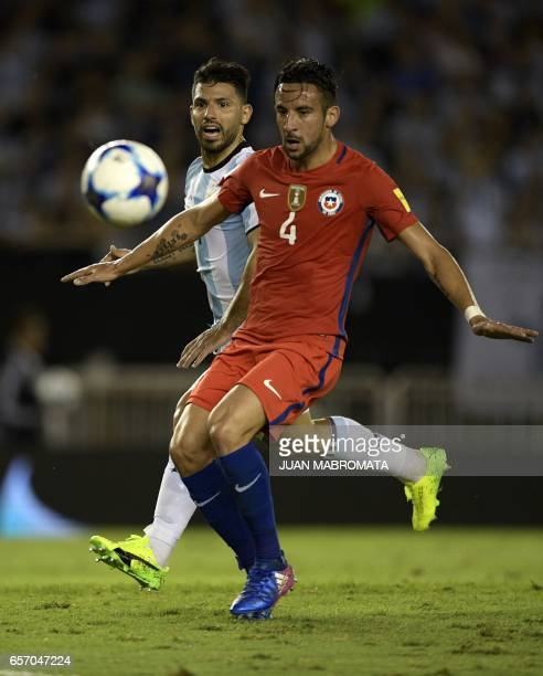 Chile's defender Mauricio Isla and Argentina's Sergio Aguero vie for the ball during their 2018 FIFA World Cup qualifier football match at the...