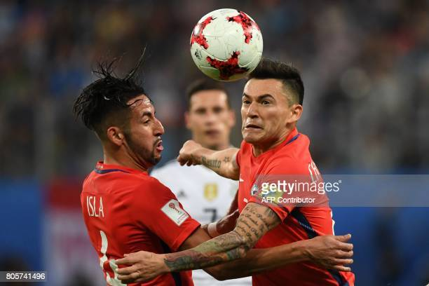 Chile's defender Mauricio Isla and Chile's midfielder Charles Aranguiz eye the ball during the 2017 Confederations Cup final football match between...