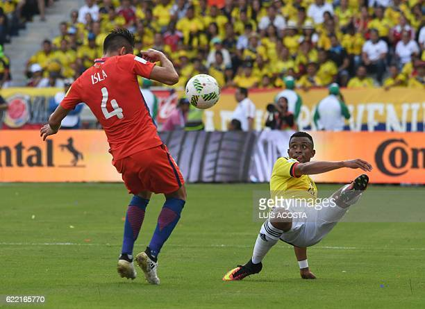 Chile's defender Mauricio Isla and Colombia's defender Yerry Mina vie for the ball during their 2018 FIFA World Cup qualifiers football match in...