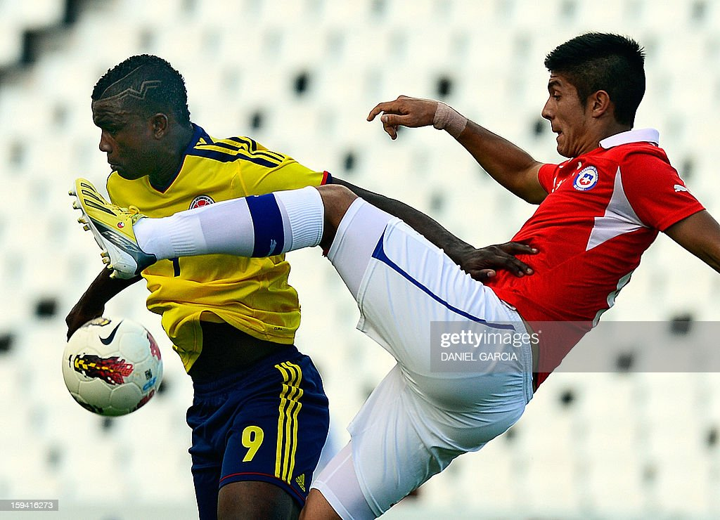 Chile's defender Valber Huerta vies for the ball with Colombia's forward Jhon Cordoba during their Group A South American U-20 tournament football match at Malvinas Argentinas stadium in Mendoza, Argentina, on January 13, 2013. Four South American teams will qualify for the FIFA U-20 World Cup Turkey 2013.