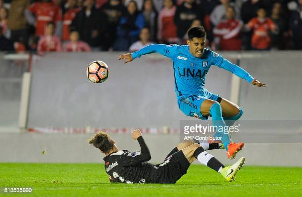 Chile's Deportes Iquique midfielder Luis Bustamante vies for the ball with Argentina's Independiente defender Nicolas Tagliafico during their Copa...