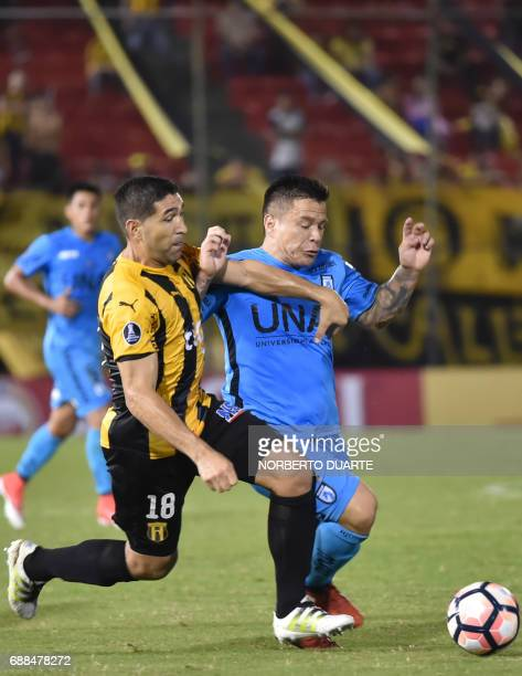 Chile's Deportes Iquique player Alvaro Ramos vies for the ball with Luis Cabral of Paraguay's Guarani during their Libertadores Cup football match at...