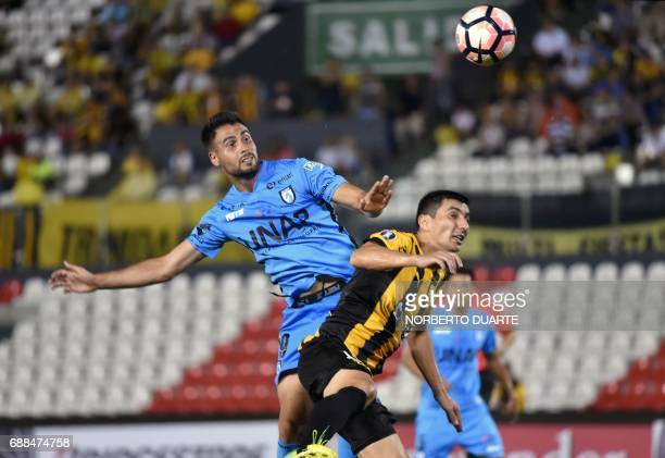 Chile's Deportes Iquique player Diego Bielkiewicz vies for the ball with Tomas Bartomeus of Paraguay's Guarani during the Copa Libertadores football...