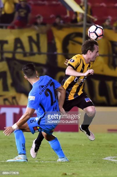 Chile's Deportes Iquique player Eduardo Diaz vies for the ball with Hernan Novick of Paraguay's Guarani during their Copa Libertadores football match...