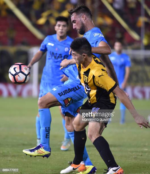 Chile's Deportes Iquique player Enzo Guerrero battles for the ball with Robert Rojas of Paraguay's Guarani during their Copa Libertadores football...