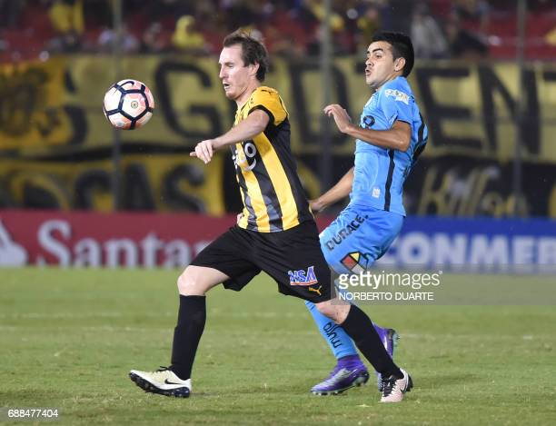 Chile's Deportes Iquique player Enzo Guerrero vies for the ball with Hernan Novick of Paraguay's Guarani during their Libertadores Cup football match...