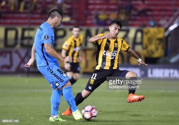 Chile's Deportes Iquique player Mauricio Morales vies for the ball with Epifanio Garcia of Paraguay's Guarani during their Libertadores Cup football...