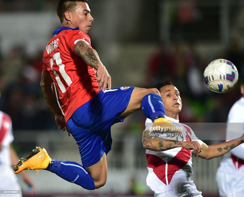Chile s Eduardo Vargas L scores against Peru during a friendly