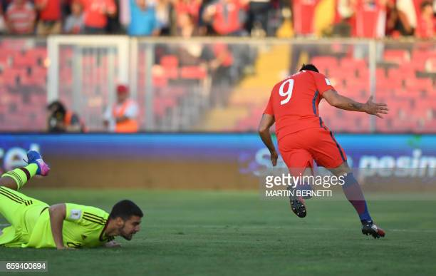 Chile's Esteban Paredes celebrates after scoring against Venezuela during their 2018 FIFA World Cup qualifier football match in Santiago Chile on...