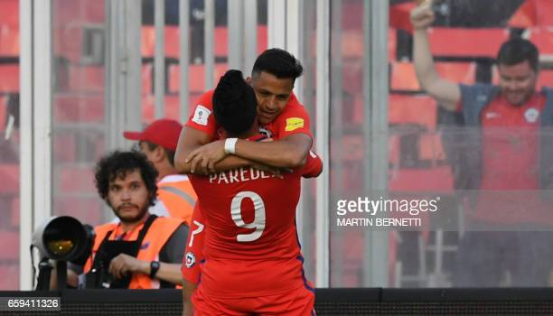 Chile's Esteban Paredes celebrates with teammate forward Alexis Sanchez after scoring against Venezuela during their 2018 FIFA World Cup qualifier...