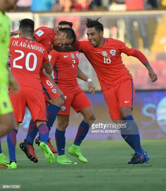 Chile's Esteban Paredes celebrates with teammates after scoring against Venezuela during their 2018 FIFA World Cup qualifier football match in...