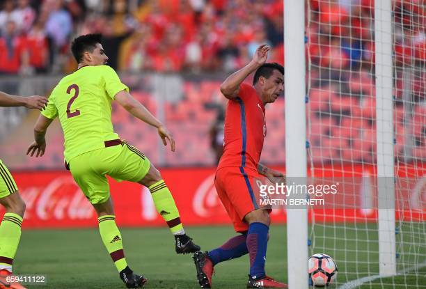 Chile's Esteban Paredes scores his second goal against Venezuela during their 2018 FIFA World Cup qualifier football match in Santiago Chile on March...