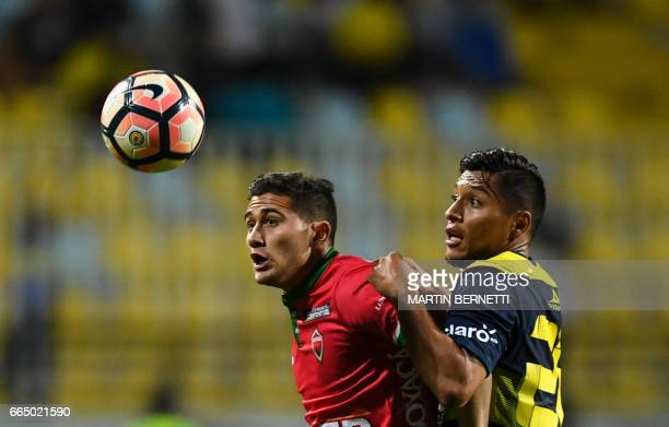 Chile's Everton player Dilan Zuniga vies for the ball with Colombia's Patriotas FC footballer Uvaldo Luna during their Copa Sudamericana football...