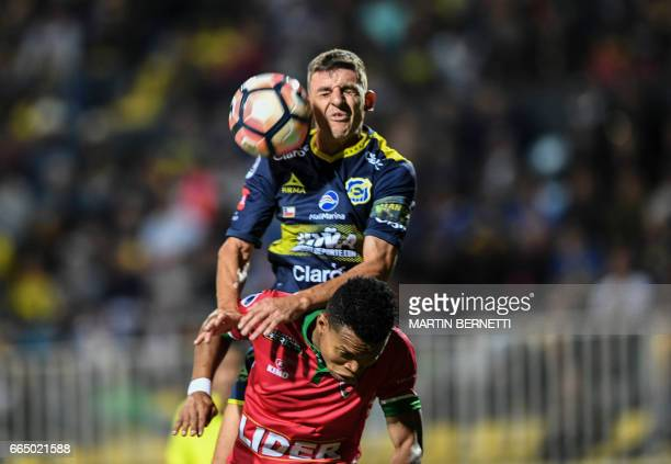 Chile's Everton player Marcos Velasquez vies for the ball with Colombia's Patriotas FC footballer Edis Ibarguen during their Copa Sudamericana...