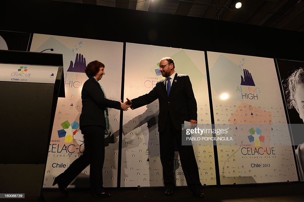 Chile's Foreign Minister Rafael Moreno (R) and the High Representative of the Union for Foreign Affairs and Security Policy, Catherine Ashton, shake hands after offering a press conference at the Espacio Riesco, on the eve of the weekend's CELAC-EU Summit, in Santiago, on January 25, 2013. More than 40 Heads of State and Government of the Community of Latin American and Caribbean States (CELAC) and the European Union (EU) will meet on January 26 and 27 to promote a strategic partnership between the two regions.