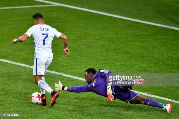 TOPSHOT Chile's forward Alexis Sanchez advances with the ball past Cameroon's goalkeeper Joseph Ondoa during the 2017 Confederations Cup group B...